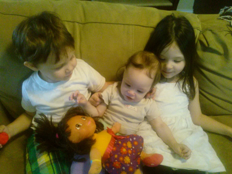 Listening to Dora's doll birthday song with big bro and big sis